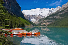 Docked canoes, lake louise, banff national park Royalty Free Stock Image