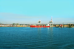 Docked cargo or container ship. Stock Photos