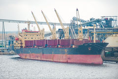 Docked cargo ship Stock Images