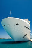Docked cruise ship. Luxury white cruise ship docked in a harbor royalty free stock photos