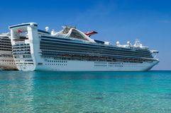 Docked Cruise Ship. Two cruise ships docked in a tropical port of call Stock Images