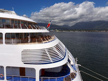 Docked cruise ship with sea and mountains Stock Photo