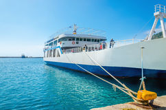 Docked Greek Ferry in painted typical blue-white colors waiting Stock Photos
