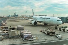 Japan Airlines Planes. A docked Japan Airlines airplane about to be loaded and boarded Stock Photography