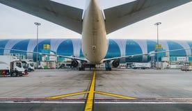 Docked jet aircraft in Dubai airport Royalty Free Stock Photo