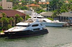 Docked luxury yacht. Wealthy waterfront neighborhood in Florida Stock Image