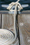 Docked at the marina. Close up of rope and cleat, a sailboat docked at the marina in yellowstone national park, wyoming Stock Photos