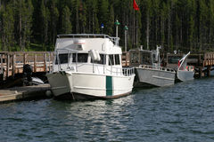 Docked motor boats. Docked boats of the national park service in yellowstone national park, wyoming Stock Photo
