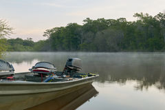 Docked river fishing boat and crisp sunrise mist. A river fishing boat docked on the banks of the Altamaha River in Georgia during a crisp misty, morning Royalty Free Stock Photos