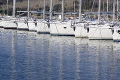 Docked sailboats. Sailboats docked in a marina stock image