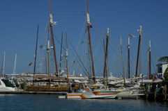 Docked sailboats. Docked multiple sailboats in key west Florida blue skies and blue water Stock Photo