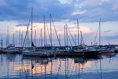 Docked sailboats at sunset Royalty Free Stock Photography