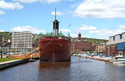 Docked ship in Duluth, MN. The retired William A. Irvin ship at a Duluth boat yard serves as a museum. The city of Duluth, MN is in the background Royalty Free Stock Images