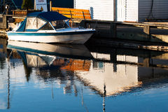 Docked, small, private speed boat Royalty Free Stock Images