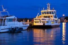Docked tourist ships Stock Image