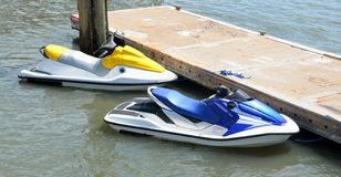 Docked water scooters Stock Photos