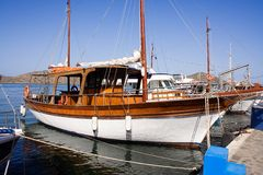 Docked Yacht. Small wooden yacht docked at the harbour royalty free stock images