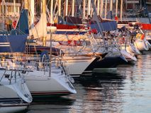 Docked Yachts. Marina with docked yachts at sunset royalty free stock image