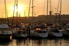 Docked Yachts. Marina with docked yachts at golden sunset Royalty Free Stock Photos