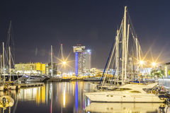 Docked yachts in Barcelona. Harbot at night stock photo