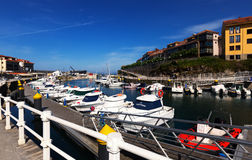 Docked yachts lying at Llanes, Spain. LLANES, SPAIN - JULY 3, 2015: Docked yachts lying at Llanes, Spain stock photos