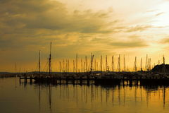 Docked yachts in marina at sunset. Docked yachts in marina sea port at dusk sunset background. Baltic sea, scandinavia, Europe stock image