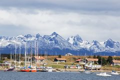 Docked Yachts, Ushuaia and Beagle Channel, Tierra del Fuego, Argentina. Yachts docked at Ushuaia, Argentina with the Martial Mountains as a backdrop. Ushuaia is stock image