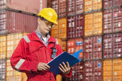 Docker checking consignment notes Royalty Free Stock Photos