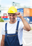 Docker greets to the camera. Smiling docker on a seaport says hello to the camera Stock Image