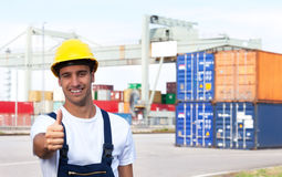Docker on a seaport showing thumb up Royalty Free Stock Photo
