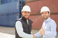 Docker and supervisor handshaking in front of containers Royalty Free Stock Photography