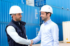 Docker and supervisor handshaking in front of containers Royalty Free Stock Photo