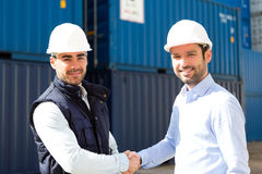Docker and supervisor handshaking in front of containers Royalty Free Stock Image