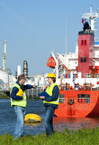 Dockers. Discussing an issue with a moored ship in an industrial harbor Royalty Free Stock Images