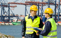 Dockers in a container harbor. Two dockers at work in a big container harbor Stock Images