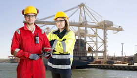 Dockers posing in front of a container ship stock photos