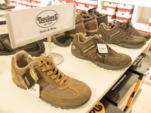 Dockers. Shoes in a store with copy space - focus is best on the sign Royalty Free Stock Images