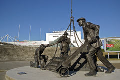 Dockers Statue. The Dockers statue sited in the Royal Victoria Dock outside the front of the ExCel exhibition centre it shows Dockers at work in the 1800s cast Stock Images