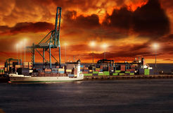 Docking. A ship docking in the evening with a spactacular sunset Royalty Free Stock Photos