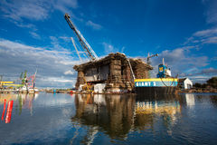 Docking oil rig at the Gdansk Shipyard under construction Royalty Free Stock Photo