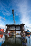 Docking oil rig at the Gdansk Shipyard under construction with f Stock Photography