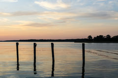 Docking poles in the sunset stock images