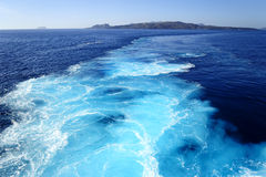 Docking at santorini. Sailing to santorini in the aegean. the sky blue waves behind the ship Stock Images