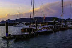 Docking station. A boats docking at a yard photograph in early morning royalty free stock photos