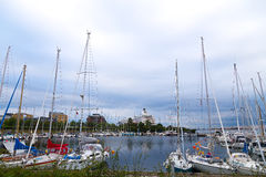 Docking yachts against the grey skies Stock Photo