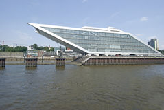 Dockland Hamburg harbour, Germany. Office building with ship form on quayside Stock Photos