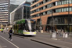 Docklands, Australia - September 25th 2018: Tram riding down Collins Street, Docklands, towards Victoria Harbour. stock photos