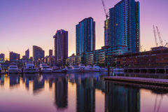Docklands high rise residential buildings and yachts. Docklands, Melbourne high rise residential buildings and moored yachts at dawn Stock Photo