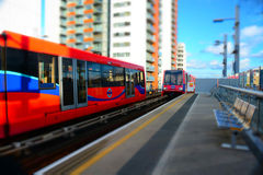 Docklands Light Railway. London UK. Miniature tilt shift effect for the trains entering and leaving a station on the DLR system in London Stock Photography