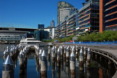Docklands in Melbourne, Victoria, Australia. Victoria Harbor in Docklands in morning hours, Docklands, Australia. Docklands is renewed suburb of Melbourne royalty free stock images